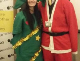 fundraising auction christmas event dressed up as santa and a tree