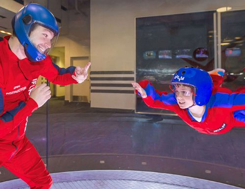 Indoor skydiving with two people from a fundraising auction event