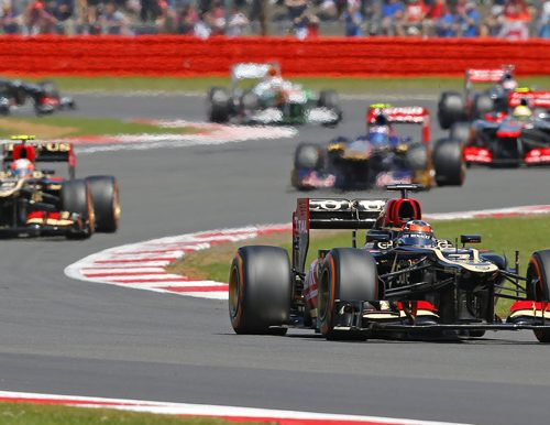 F1 cars in a Grand Prix taken on a trip won at a fundraising auction