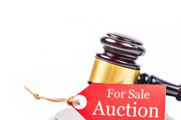 a tag of auction with a wooden gavel